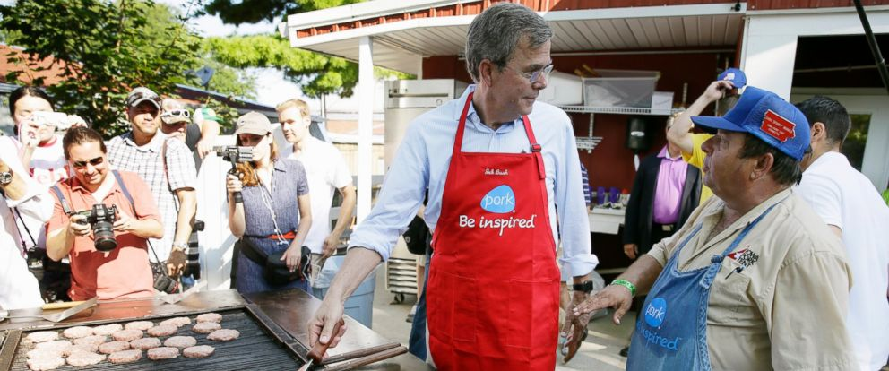 PHOTO: In this Aug. 14, 2015, file photo, Republican presidential candidate, former Florida Gov. Jeb Bush, talks with Dana Wanken, right, as he works the grill in the Iowa Pork Producers tent during a visit to the Iowa State Fair in Des Moines.