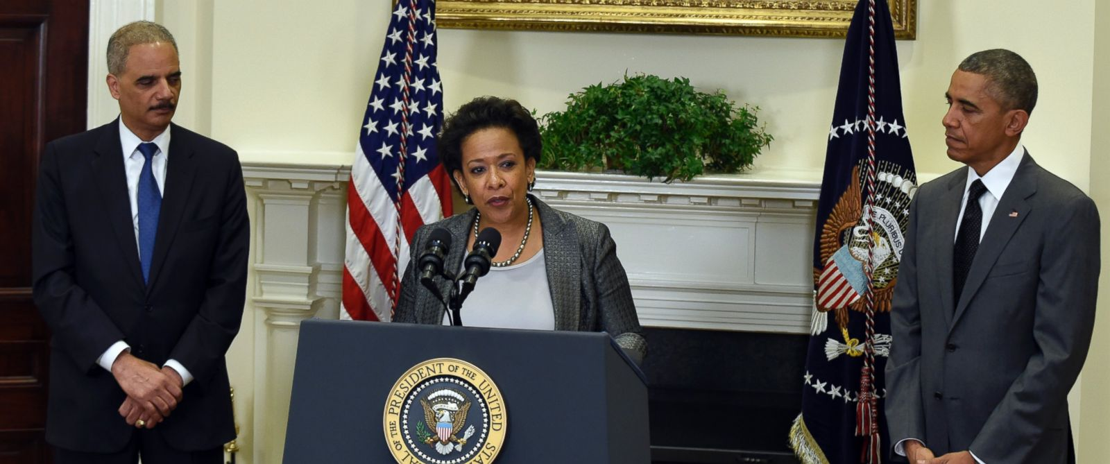 PHOTO: President Barack Obama listens at right as U.S. Attorney Loretta Lynch speaks in the Roosevelt Room of the White House in Washington, Saturday, Nov. 8, 2014, after Obama nominated Lynch to be the Attorney General succeeding Eric Holder, left.