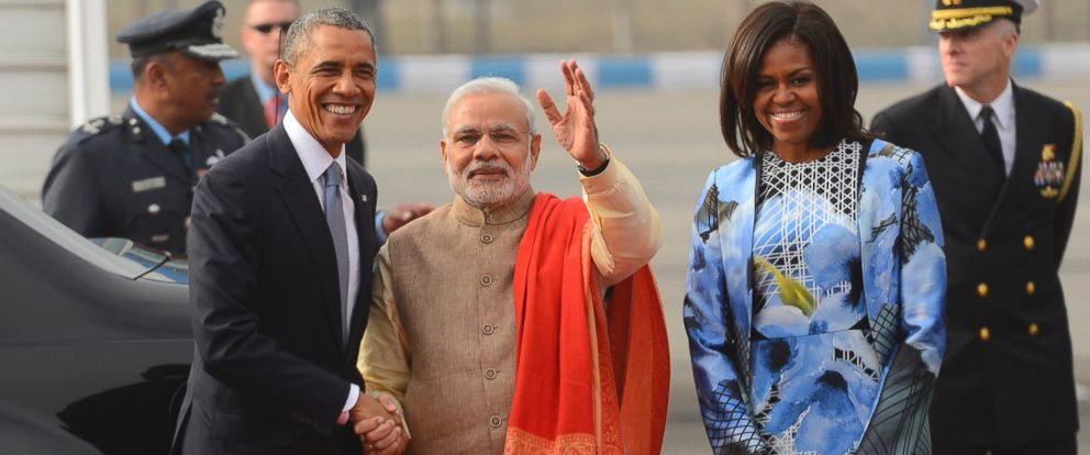 U.S. President Barack Obama shakes hand with Indian Prime Minister Narendra Modi, as first lady Michelle Obama stand beside them, upon arrival at the Palam Air Force Station in New Delhi, India, Sunday, Jan. 25, 2015.