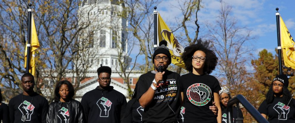 PHOTO: Jonathan Butler, front left, addresses a crowd following the announcement that University of Missouri System President Tim Wolfe would resign on Nov. 9, 2015, at the University in Columbia, Mo.