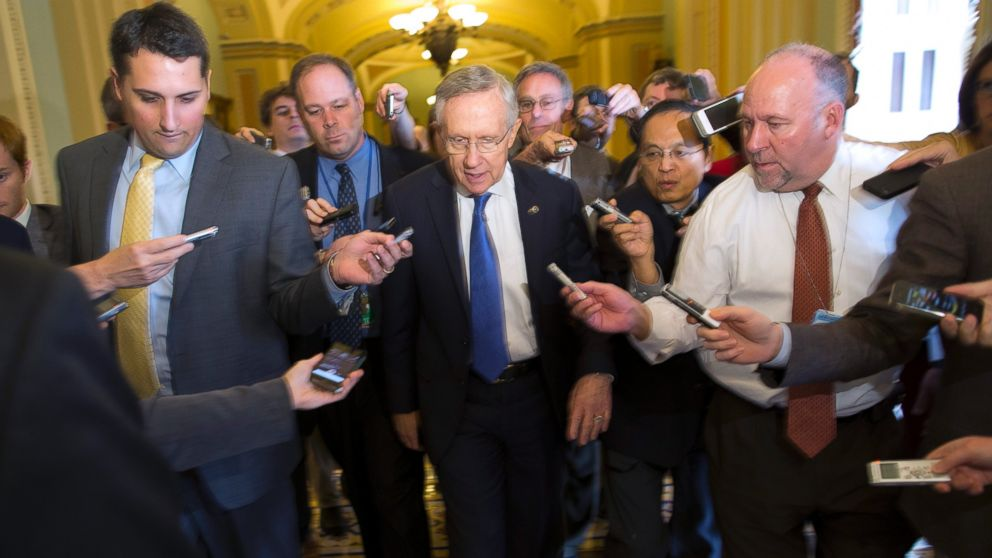 PHOTO: Senate Majority Leader Sen. Harry Reid, D-Nev., is surrounded by reporters