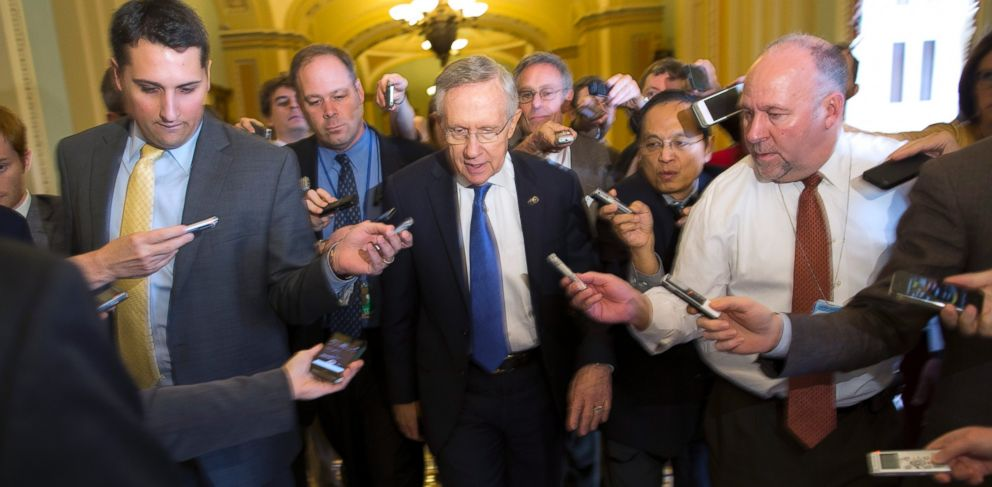 PHOTO: Senate Majority Leader Sen. Harry Reid, D-Nev., is surrounded by reporters