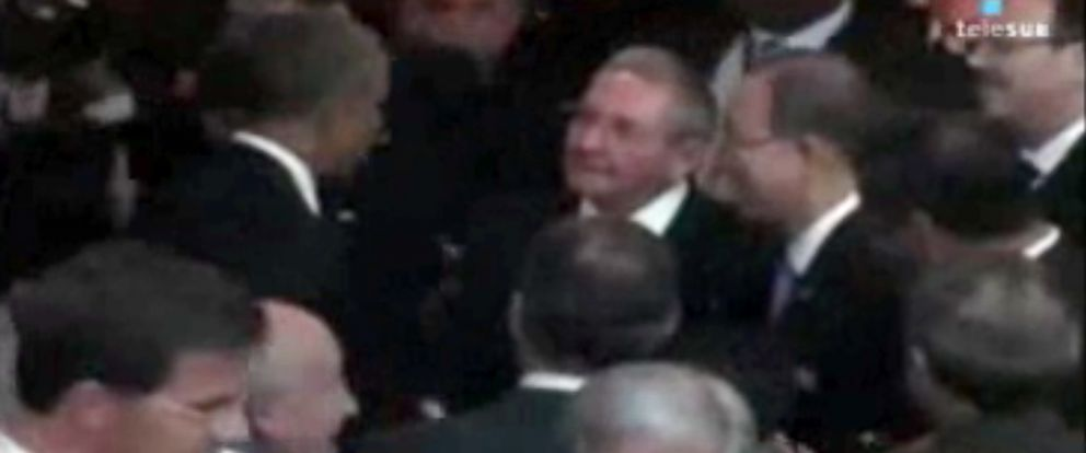 This image from Telesur video shows President Obama sharing a cordial evening handshake with Cuban President Raul Castro during a meeting on the sidelines of the Summit of the Americas Friday evening April 10, 2015 in Panama City, Panama.