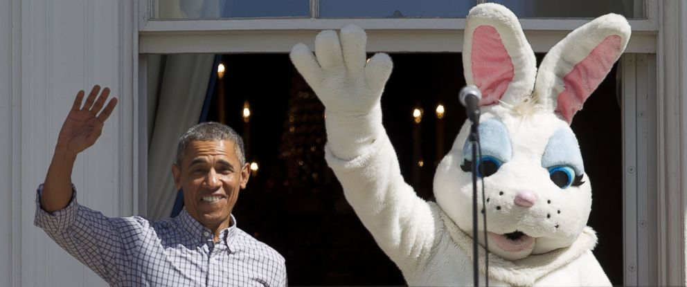 PHOTO: President Barack Obama walks out and waves with the Easter Bunny on the Truman Balcony during the White House Easter Egg Roll on the South Lawn of White House on April 6, 2015 in Washington.
