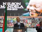 PHOTO: President Barack Obama speaks to crowds attending the memorial service for former South African president Nelson Mandela at the FNB Stadium in Soweto near Johannesburg, Dec. 10, 2013.