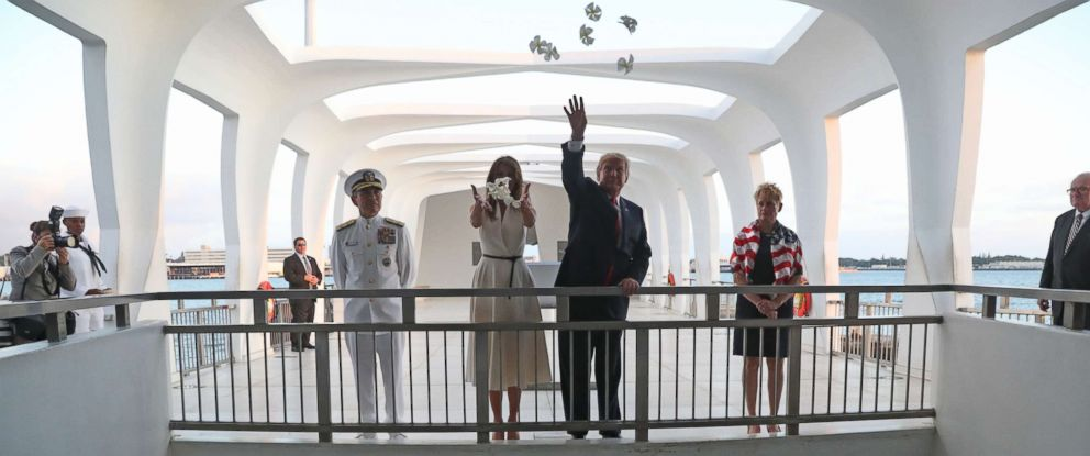 PHOTO: U.S. President Donald Trump and first lady Melania Trumpoffer flowers at the USS Arizona Memorial at the Joint Base Pearl Harbor Hickam, Hawaii, Friday, Nov. 3, 2017.