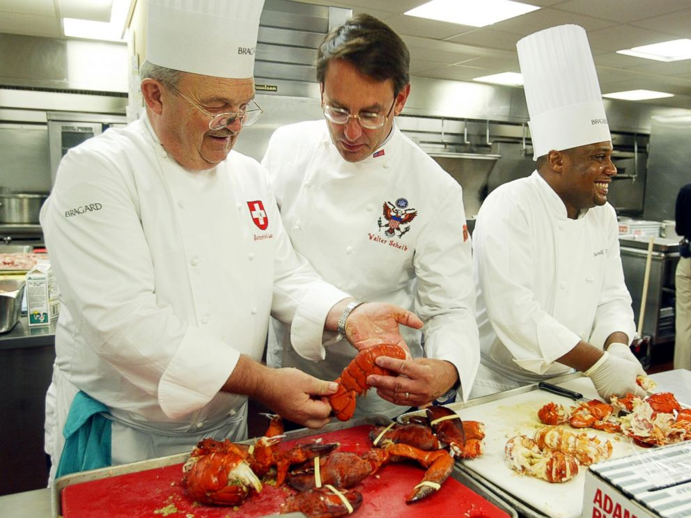 PHOTO: Heinrich Lauber, left, Chef in Charge of the Official Receptions of Switzerland, shows former White House Chef Walter Scheib, center, in this file photo, cooked lobsters, at the Willard InterContinental Washington, July 26, 2004.