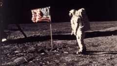 "PHOTO: This July 20, 1969 file photo provided by NASA shows astronaut Edwin E. ""Buzz"" Aldrin Jr. posing for a photograph beside the U.S. flag deployed on the moon during the Apollo 11 mission."