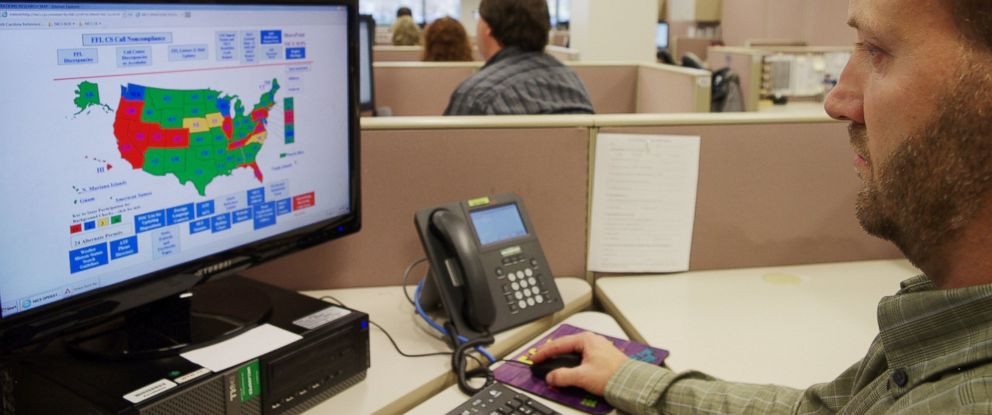 PHOTO: A researcher simulates a check done for the National Instant Criminal Background Check System or NICS, at the FBIs criminal justice center in Bridgeport, W.Va., Nov. 18, 2014.