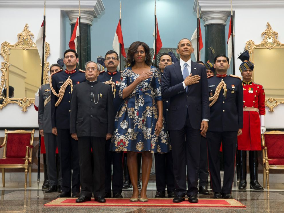 PHOTO: President Barack Obama, right, first lady Michelle Obama, center, and Indian President Pranab Mukherjee, left, stand during the US National Anthem at the State Dinner at the Rashtrapati Bhavan, in New Delhi, India, Sunday, Jan. 25, 2015.