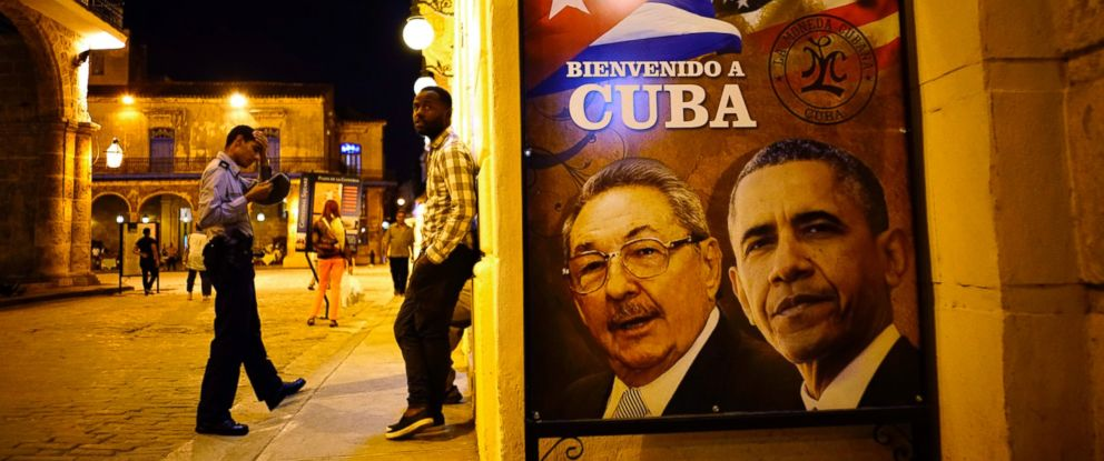 "PHOTO: A poster features portraits of Cubas President Raul Castro, left, and President Barack Obama and reads in Spanish ""Welcome to Cuba"" outside a restaurant in Havana, Cuba, March 17, 2016."