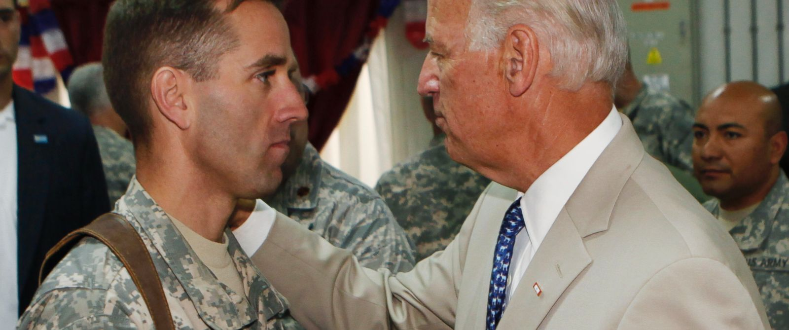 PHOTO: Vice President Joe Biden, right, talks with his son, U.S. Army Capt. Beau Biden, at Camp Victory on the outskirts of Baghdad, Iraq, July 4, 2009.