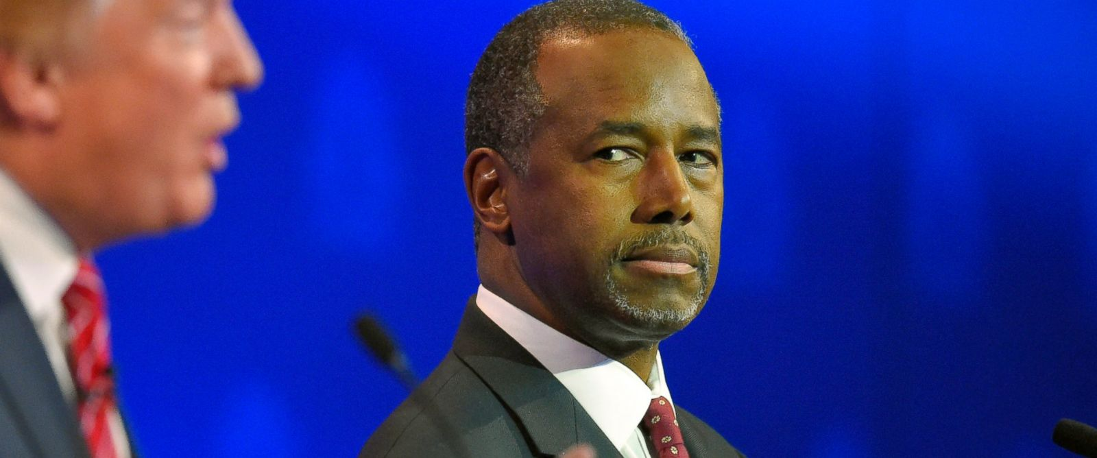 PHOTO: Ben Carson, right, watches as Donald Trump speaks during the CNBC Republican presidential debate at the University of Colorado, Oct. 28, 2015, in Boulder, Colo.