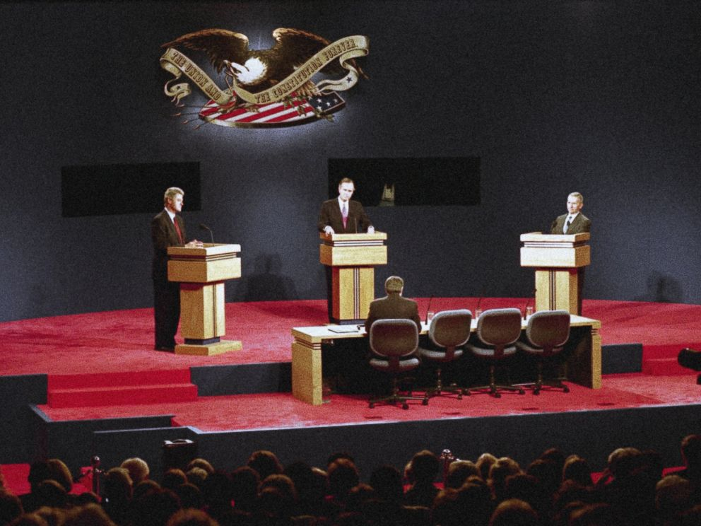 PHOTO: Presidential candidates Gov. Bill Clinton, left, President George Bush, center, and Ross Perot, right, face-off in their third and final presidential debate in East Lansing, Michigan, Oct. 19, 1992.