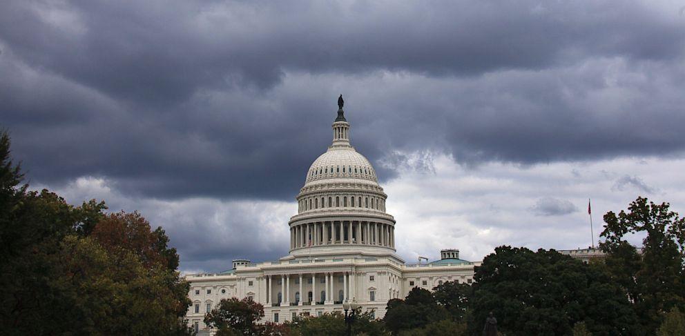 PHOTO: Dark clouds hang over U.S. Capitol in Washington