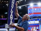 PHOTO: Jimmy Wright installs the Pennsylvania delegation placard ahead of the 2016 Democratic National Convention in Philadelphia, July 24, 2016.