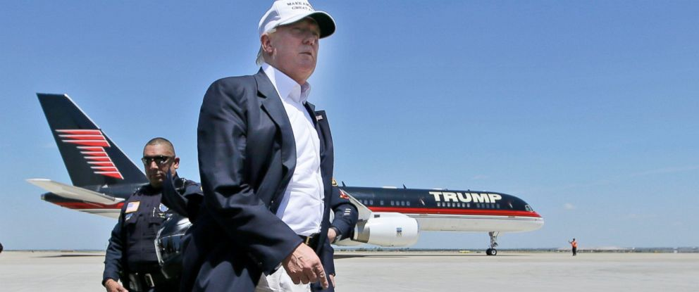 PHOTO: Republican presidential hopeful Donald Trump walks the tarmac before boarding his campaign plane to depart from Laredo, Texas, July 23, 2015.
