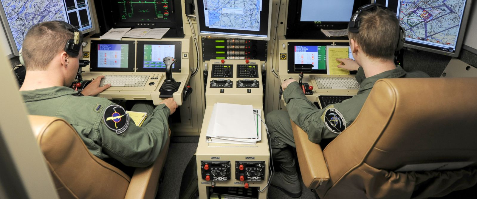 PHOTO: A student pilot and sensor operator man the controls of a MQ-9 Reaper in a ground-based cockpit during a training mission flown from Hancock Field Air National Guard Base, Syracuse, New York, June 6, 2012.