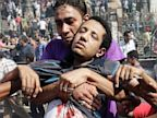 PHOTO: Supporters of Egypts ousted President Mohammed Morsi carry a wounded man