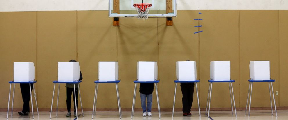 PHOTO: Voters fill out their ballots in a gym on election day at St. Sophia Greek Orthodox Church