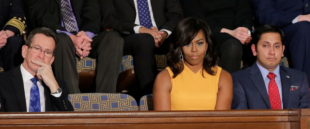 PHOTO: First Lady Michelle Obama sits next to a vacant seat to honor victims of gun violence during President Barack Obamas State of the Union address before a joint session of Congress on Capitol Hill in Washington, Jan. 12, 2016.
