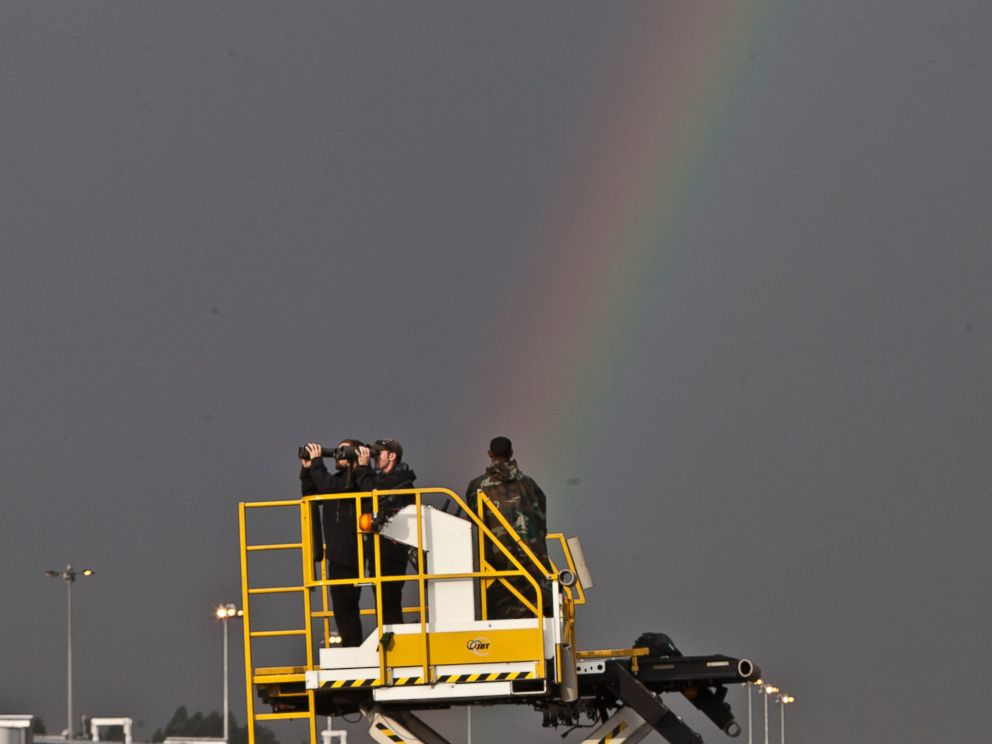 PHOTO: Secret Service Agents watch through their binoculars as a rainbow appears in the sky before President Barack Obama arrived at Bole International Airport, July 26, 2015, Addis Ababa, Ethiopia.
