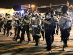 PHOTO: Police advance to clear people during a protest for Michael Brown in Ferguson, Mo., Aug. 18, 2014.