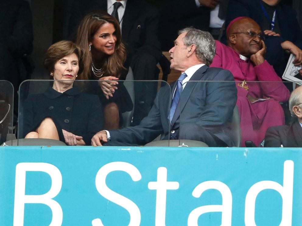 PHOTO: Jordans Queen Rania, center, speaks with Former U.S. President George W. Bush and his wife Laura during the memorial service for former South African president Nelson Mandela at the FNB Stadium in Soweto near Johannesburg, Dec. 10, 2013.