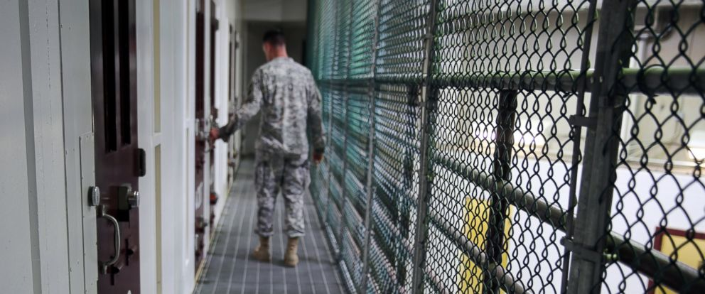 PHOTO: An Army captain walks outside unoccupied detainee cells inside Camp 6 at the U.S. detention center at Guantanamo Bay, Cuba, Feb. 6, 2016.