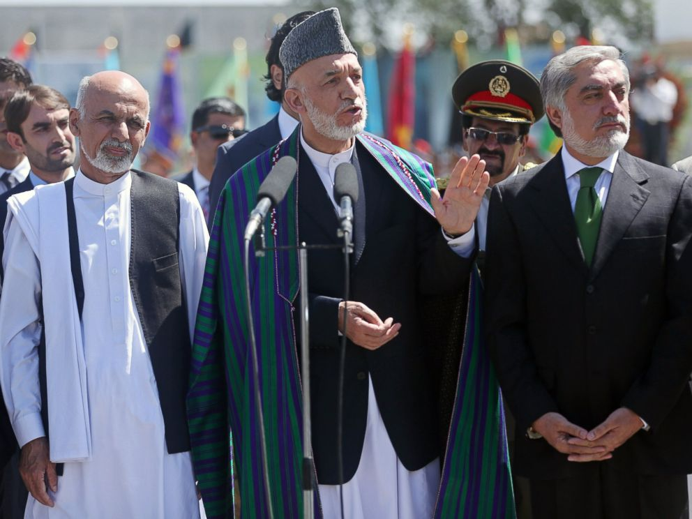 PHOTO: Afghan President Hamid Karzai, center, speaks in front of local and international media representatives during the Independence Day ceremony in Kabul, Afghanistan, Aug. 19, 2014.