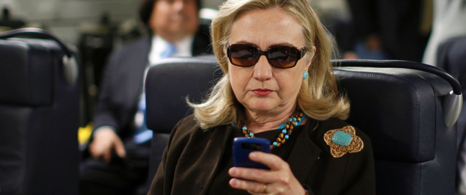 PHOTO: Secretary of State Hillary Rodham Clinton checks her Blackberry from a desk inside a C-17 military plane upon her departure from Malta, Oct. 18, 2011.