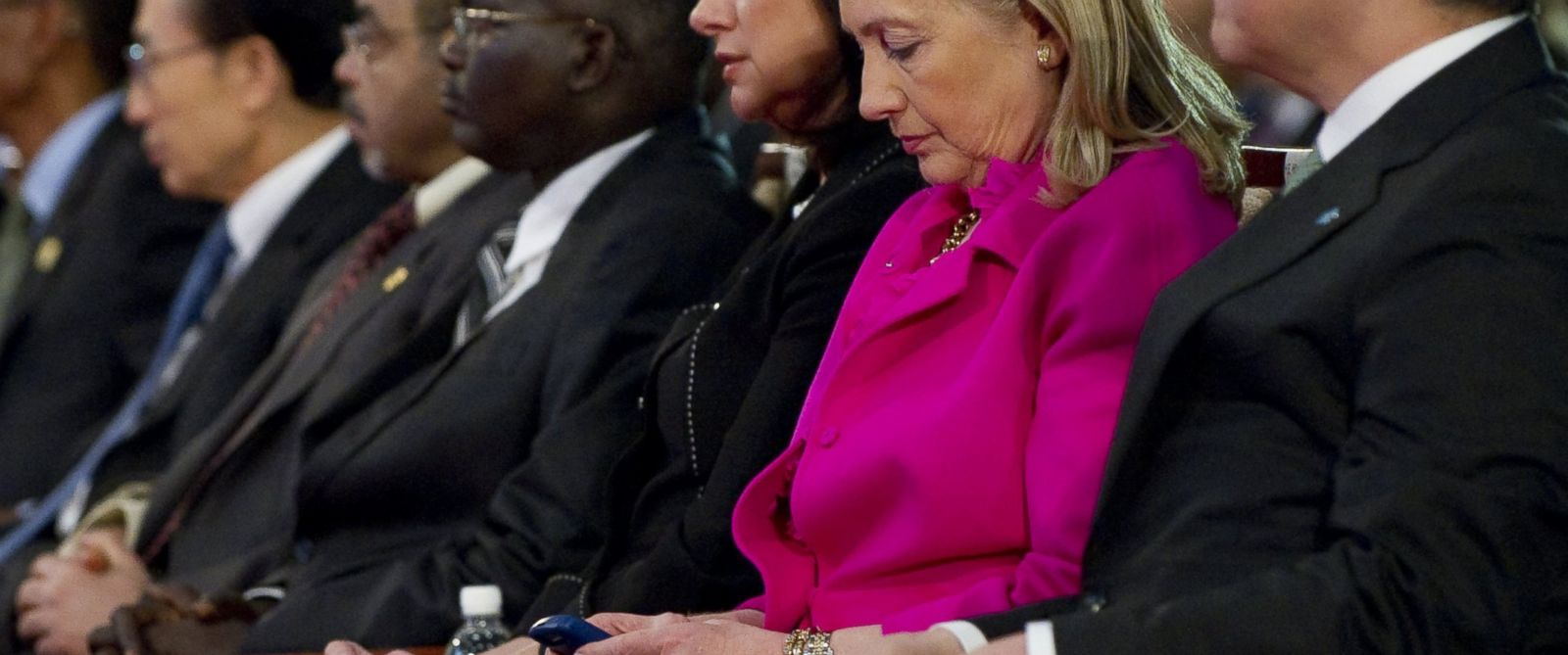 PHOTO: U.S. Secretary of State Hillary Rodham Clinton, 2nd right, checks her Blackberry phone, as she attends the Fourth High Level Forum on Aid Effectiveness in Busan, South Korea Wednesday, Nov. 30, 2011.