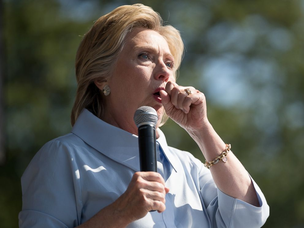 PHOTO: Democratic presidential candidate Hillary Clinton stops her speech to cough at the 11th Congressional District Labor Day festival at Luke Easter Park in Cleveland, Sept. 5, 2016.