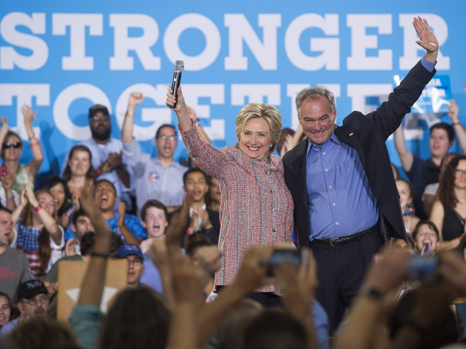 PHOTO: Democratic Presidential candidate Hillary Clinton and Sen. Tim Kaine, Democrat of Virginia, wave during a campaign rally at Ernst Community Cultural Center in Annandale, Virginia, July 14, 2016.