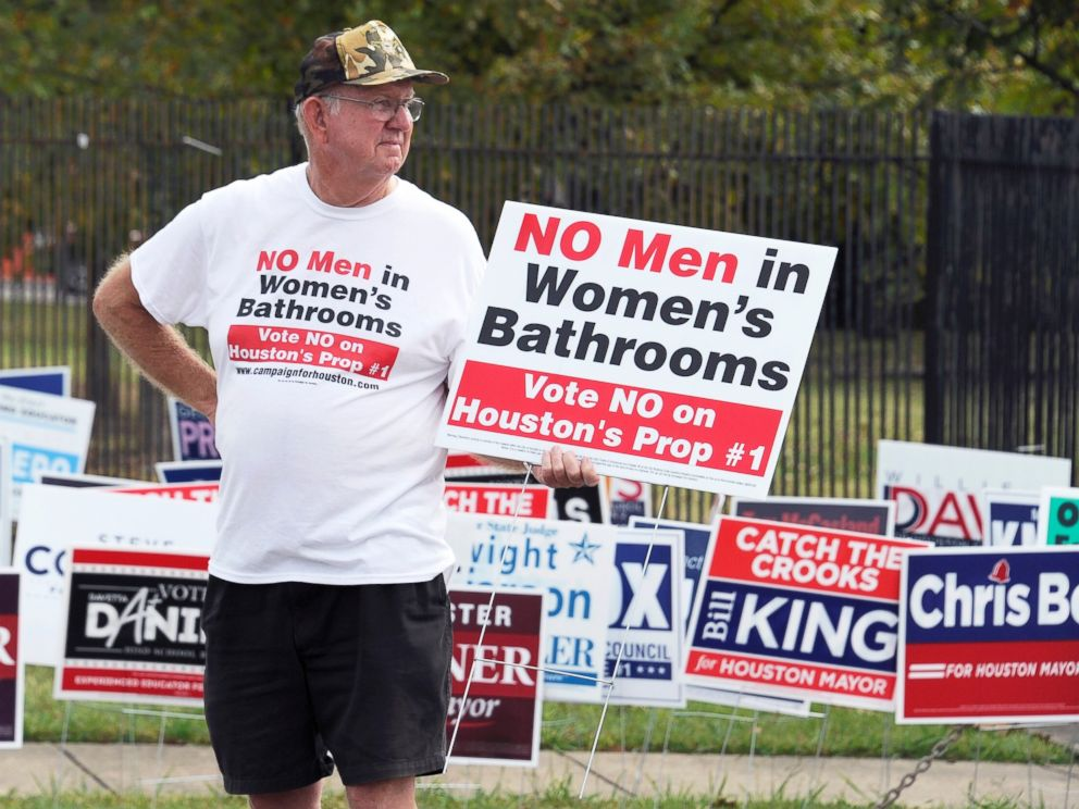 PHOTO: A man urges people to vote against the Houston Equal Rights Ordinance outside an early voting center in Houston, Oct. 21, 2015.