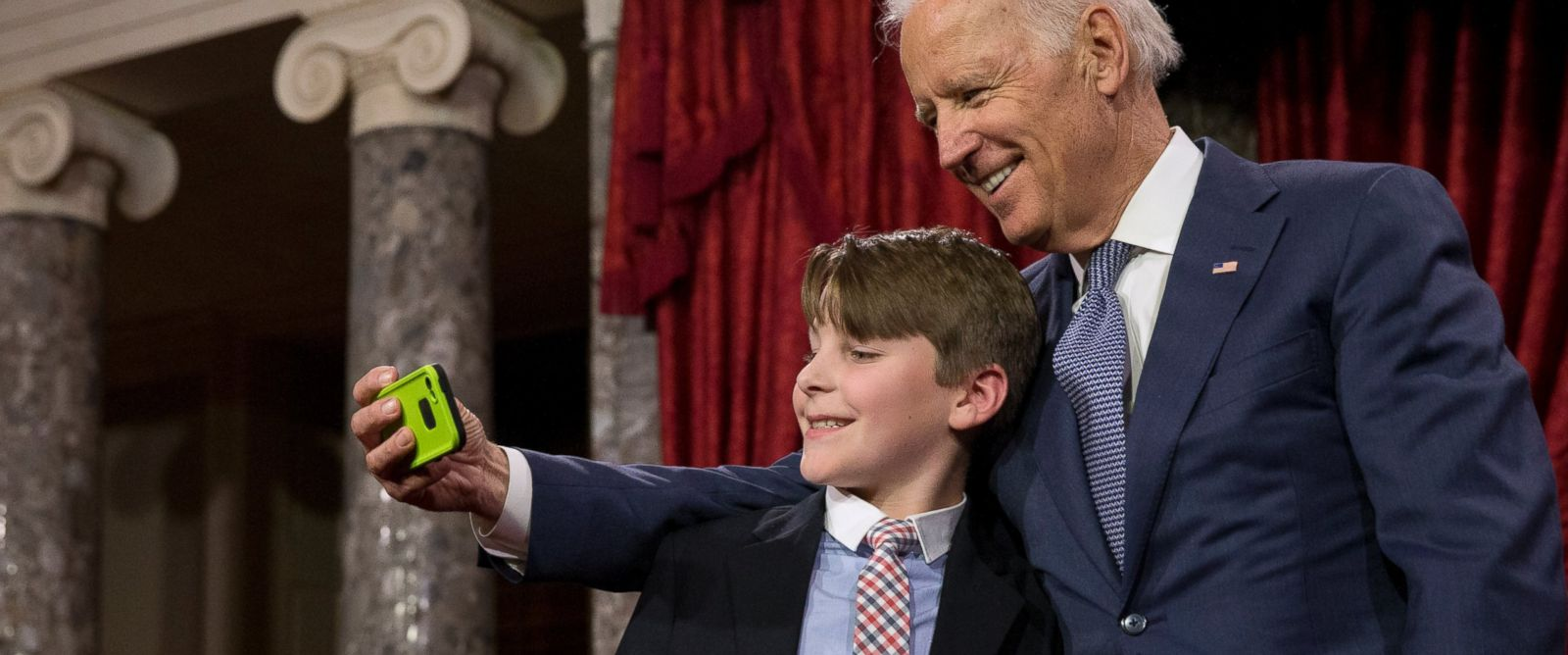 "PHOTO: Vice President Joe Biden takes a ""selfie"" with Sen. Jeanne Shaheens grandson A.J. Bellabona, Tuesday, Jan. 6, 2015, in the Old Senate Chamber of Capitol Hill in Washington."
