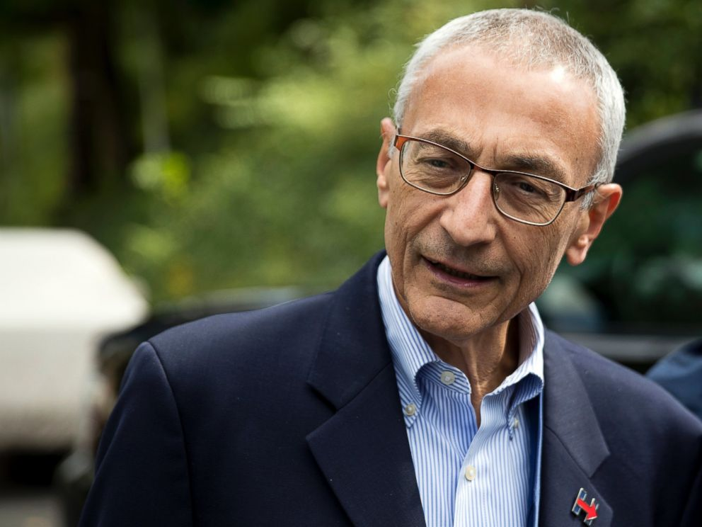 PHOTO: John Podesta speaks to members of the media outside Clintons home in Washington, Oct. 5, 2016.