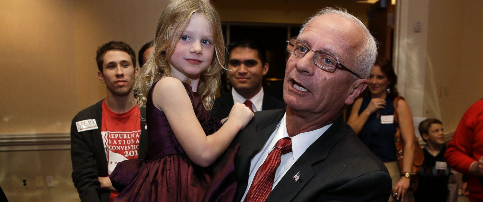 PHOTO: Republican Kerry Bentivolio holds his granddaughter Emily Lee, while greeting supporters at his election night party in Novi, Mich., Nov. 7, 2012.