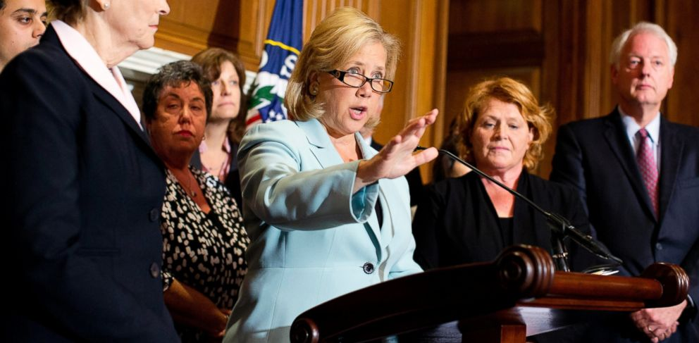 PHOTO: Sen. Mary Landrieu, D-La., center, with Sen. Jeanne Shaheen, D-N.H., left, Sen. Heidi Heitkamp, D-N.D., right, and others, speaks at a news conference and Capitol Hill in Washington, Oct. 3, 2013.