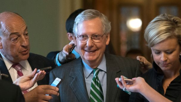 PHOTO: Senate Majority leader Mitch McConnell smiles as he leaves the chamber after announcing the release of the Republicans' healthcare bill, June 22, 2017.