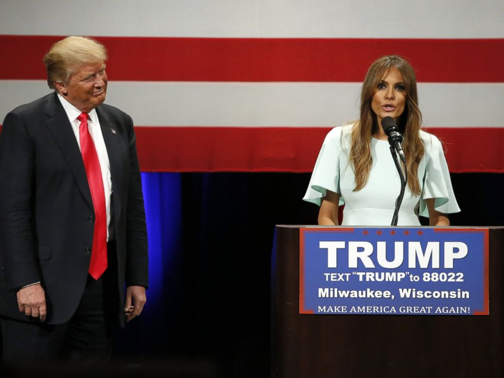 PHOTO:Donald Trump listens to his wife Melania as she addresses the crowd during a rally at the Milwaukee Theatre, April 4, 2016, in Milwaukee.