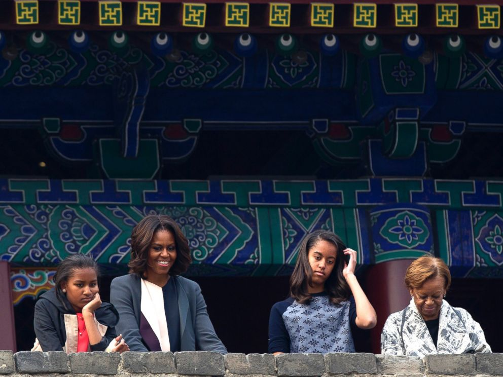 PHOTO: U.S. first lady Michelle Obama, her daughters and mother watch a performance on the top of an ancient city wall in Xian, in northwestern Chinas Shaanxi province, March 24, 2014.