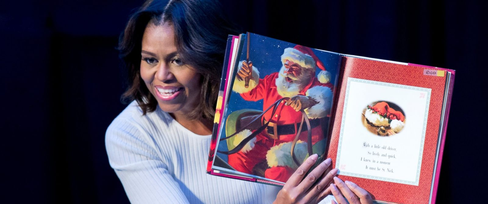 "PHOTO: First lady Michelle Obama reads ""Twas the night before Christmas""? to patients, families, and staff at Childrens National Health System in Washington, Dec. 15, 2014."