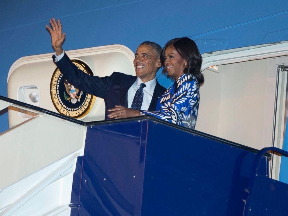 PHOTO: President Barack Obama and first lady Michelle Obama board Air Force One at King Khalid International Airport, in Riyadh, Saudi Arabia, Jan. 27, 2015.