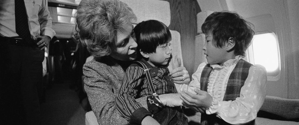 PHOTO: First Lady Nancy Reagan with 4-year-old Lee Kil Woo, center, and 7-year-old Ahn Ji Sook on Air Force One as they flew towards Anchorage, Alaska, Nov. 13, 1983. The 2 children flew with the Reagans in order to receive open-heart surgery.