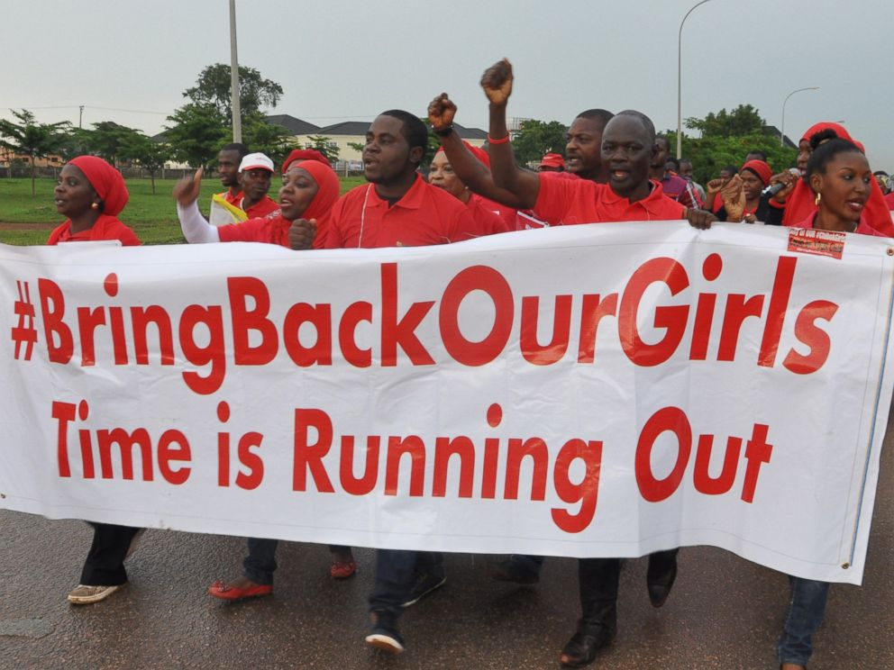 PHOTO: People shout slogans and hold a banner during a demonstration calling on the government to rescue the kidnapped girls of the government secondary school in Chibok, Nigeria on Sept. 11, 2014 in Abuja, Nigeria.