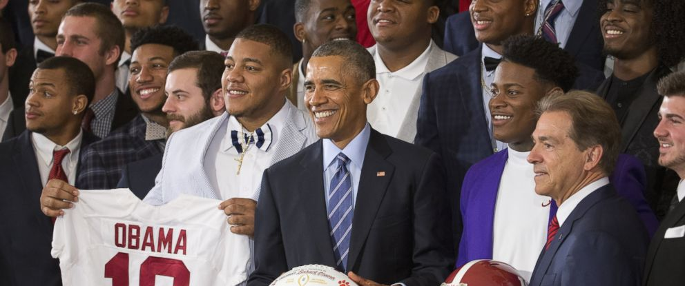 PHOTO: President Barack Obama holds a football for a group portrait as he honors the 2015-2016 College Football Playoff National Champion Alabama Crimson Tide football team, March 2, 2016.