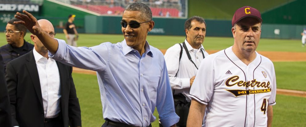 PHOTO: President Barack Obama, left, walks with Rep. Dan Kildee, D-Mich., as he makes a visit to the Congressional baseball game at Nationals Park, June 11, 2015, in Washington.