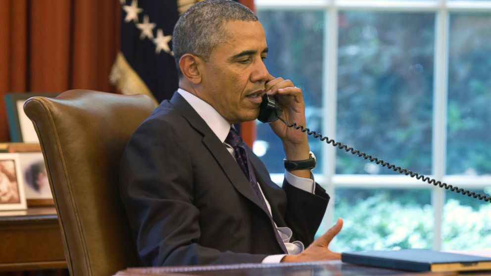 PHOTO: President Barack Obama speaks on the phone in the Oval Office of the White House in Washington, June 2, 2014.