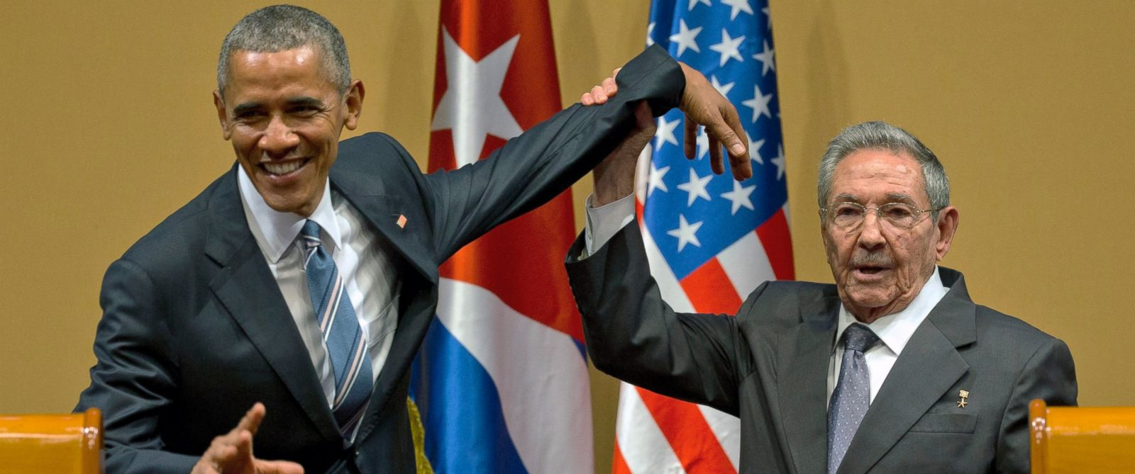 PHOTO: Cuban President Raul Castro, right, tries to lift up the arm of President Barack Obama at the conclusion of their joint news conference at the Palace of the Revolution, March 21, 2016, in Havana, Cuba.